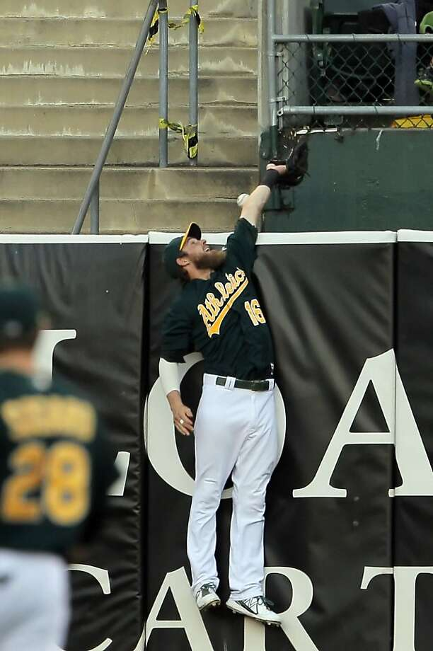 Josh Reddick can't get to a ball hit over the fence by Luis Valbuena in the third inning. The Oakland Athletics played the Chicago Cubs at O.co Coliseum in Oakland, Calif., on Wednesday, July 3, 2013. Photo: Carlos Avila Gonzalez, The Chronicle