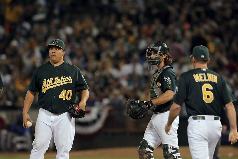 Bartolo Colon waits on the mound as manager Bob Melvin comes out for a conference in the seventh inning. Melvin left Colon in the game and he pitched his way out of the jam. The Oakland Athletics played the Chicago Cubs at O.co Coliseum in Oakland, Calif., on Wednesday, July 3, 2013. Photo: Carlos Avila Gonzalez, The Chronicle