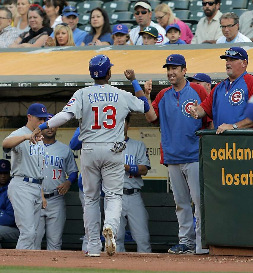 Starlin Castro high fives teammates after scoring in the first inning. The Oakland Athletics played the Chicago Cubs at O.co Coliseum in Oakland, Calif., on Wednesday, July 3, 2013. Photo: Carlos Avila Gonzalez, The Chronicle