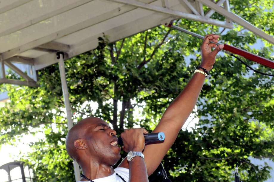 Jermaine Wells lead singer of The ILL Funk Ensemble performs at RockinO on the River 2013 on Wednesday July 3, 2013 in Troy, N.Y. (Michael P. Farrell/Times Union) Photo: Michael P. Farrell / 10022876A