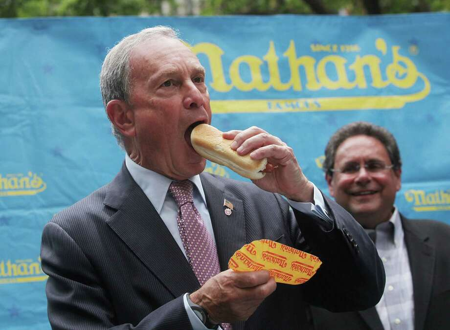 NEW YORK, NY - JULY 03:  New York City Mayor Michael Bloomberg consumes a dog at the Nathan's Famous Fourth of July International Hot Dog Eating Contest weigh-in ceremony on July 3, 2013 in the Brooklyn borough of New York City. The annual hot dog eating event is expected to draw up to 40,000 fans on July 4, in the Coney Island section of Brooklyn.  (Photo by Mario Tama/Getty Images) ORG XMIT: 173071810 Photo: Mario Tama, Getty / 2013 Getty Images