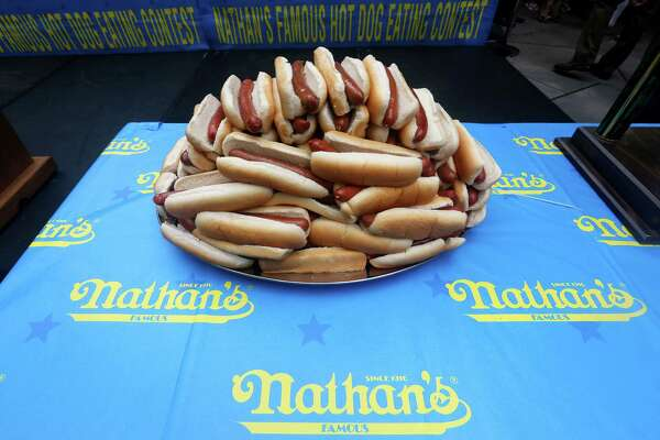 Hot dogs are on display during the official weigh-in for the Nathan's Fourth of July hot dog eating contest, Wednesday, July 3, 2013 at City Hall park in New York.  (AP Photo/Mary Altaffer) ORG XMIT: NYMA107