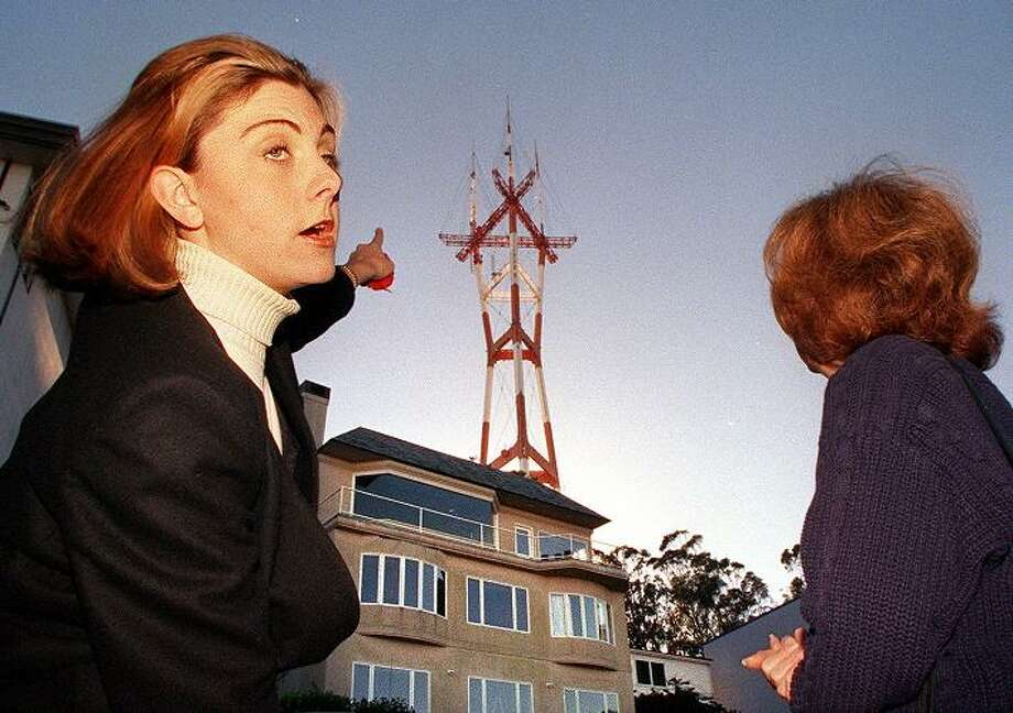 Twin Peaks Improvement Association members Christine Linnenbach and Nancy Hogan, clearly not happy about the tower. Photo: LIZ HAFALIA, STAFF / CHRONICLE