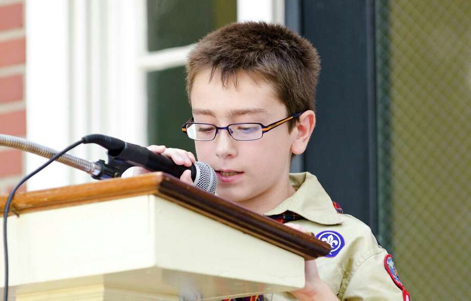 Joseph Gregory, 9, of Trumbull, recites a portion of the Declaration of Independence during the Town of Trumbull's second annual Declaration of Independence reading at Trumbull Town Hall on Thursday, July 4, 2013. Photo: Amy Mortensen / Connecticut Post Freelance
