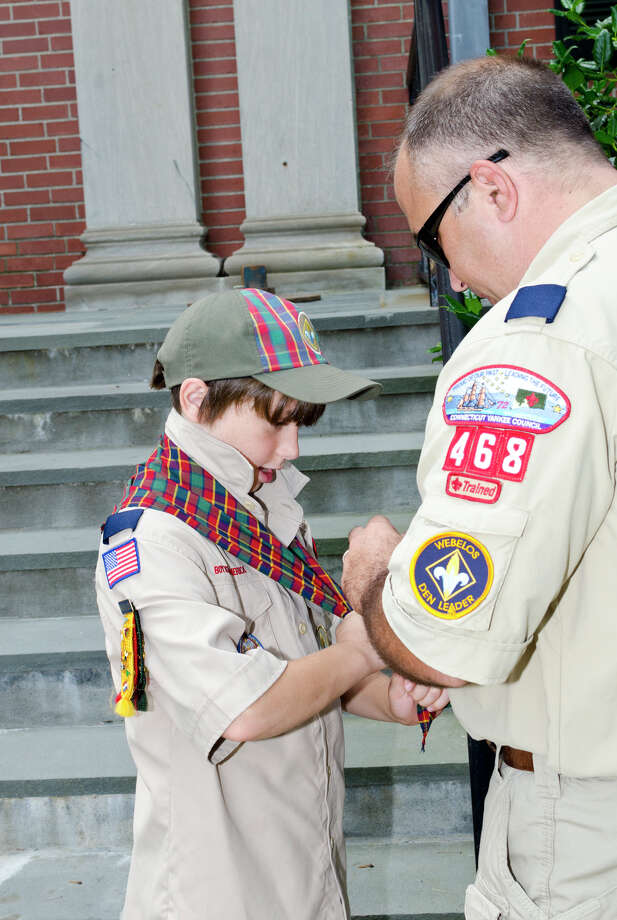 Den leader Mark Franzen, ties a neckerchief on his son, Colin Franzen, 10, of Trumbull Cub Scout Pack 468 Den 2, during the Town of Trumbull's second annual Declaration of Independence reading at Trumbull Town Hall on Thursday, July 4, 2013. Photo: Amy Mortensen / Connecticut Post Freelance