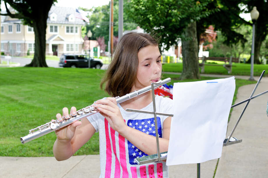 Delaney Franzen, 11, of Trumbull plays the flute during the Town of Trumbull's second annual Declaration of Independence reading at Trumbull Town Hall on Thursday, July 4, 2013. Photo: Amy Mortensen / Connecticut Post Freelance