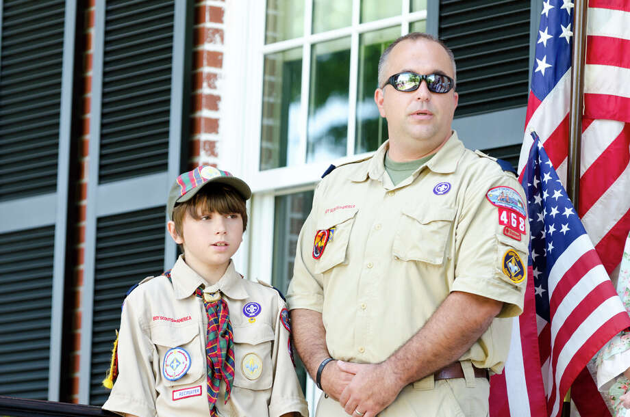 Colin Franzen, 10, of Trumbull Cub Scout Pack 468, and his father, Den Leader Mark Franzen, participte in the Town of Trumbull's second annual Declaration of Independence reading at Trumbull Town Hall on Thursday, July 4, 2013. Photo: Amy Mortensen / Connecticut Post Freelance