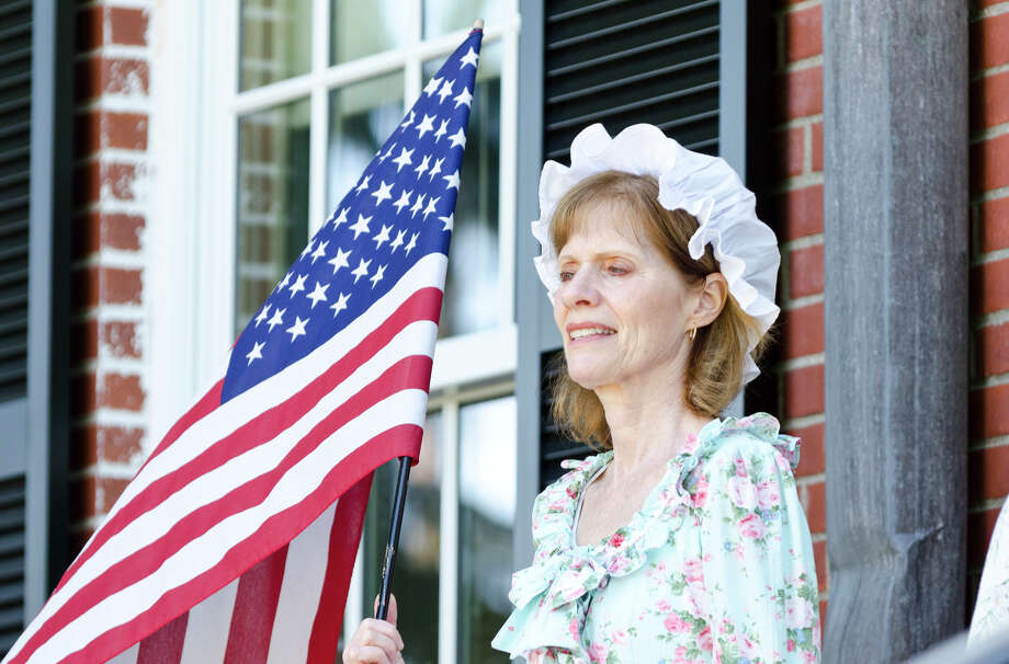 Jan Lopin, of Milford Christian Academy, holds an American flag on the steps of Trumbull Town Hall during the Town of Trumbull's second annual Declaration of Independence reading at Trumbull Town Hall on Thursday, July 4, 2013. Photo: Amy Mortensen / Connecticut Post Freelance