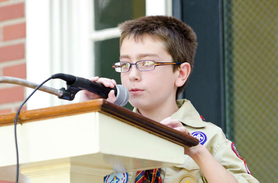 Joseph Gregory, 9, of Trumbull, recites a portion from the Declaration of Independence during the Town of Trumbull's second annual Declaration of Independence reading at Trumbull Town Hall on Thursday, July 4, 2013. Photo: Amy Mortensen / Connecticut Post Freelance