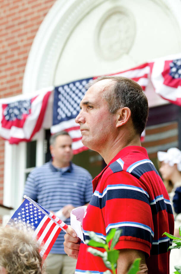 Jack Testani, of Trumbull, Chairman of the Trumbull Republican Party and Chairman of the Trumbull Police Commission, holds an American flag during the Town of Trumbull's second annual Declaration of Independence reading at Trumbull Town Hall on Thursday, July 4, 2013. Photo: Amy Mortensen / Connecticut Post Freelance
