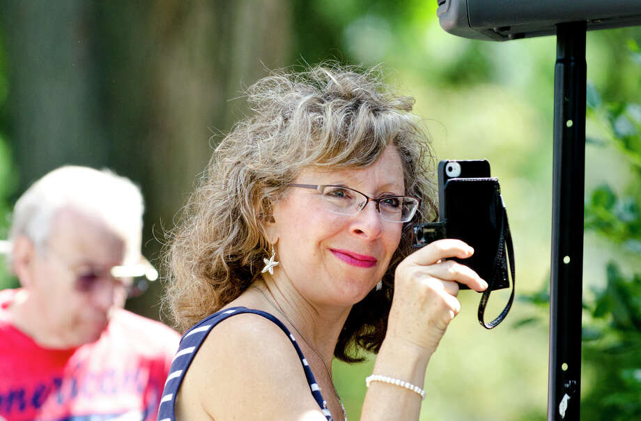 Michele Uss, of Milford, records video during the Town of Trumbull's second annual Declaration of Independence reading at Trumbull Town Hall on Thursday, July 4, 2013. Photo: Amy Mortensen / Connecticut Post Freelance