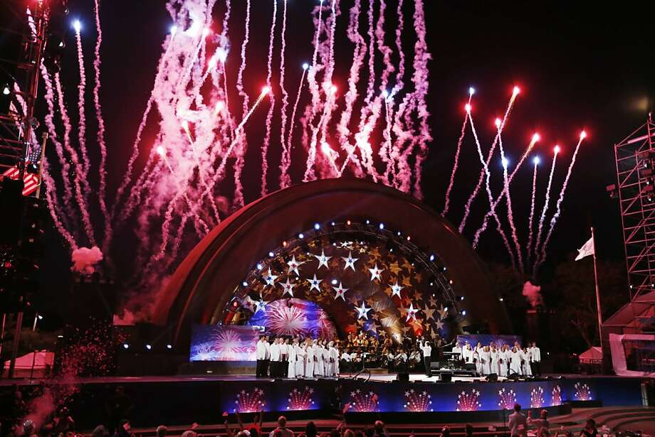 Fireworks shoot over the Hatch Shell in Boston during the Boston Pops Fourth of July concert rehearsal, Wednesday, July 3, 2013.  Photo: Michael Dwyer, Associated Press