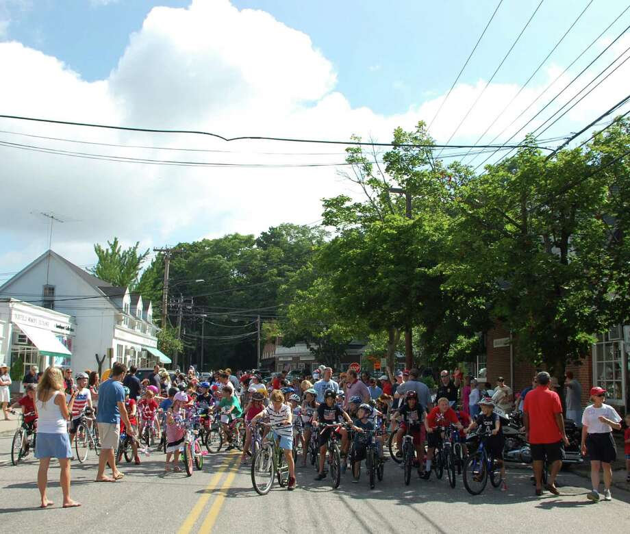 Hundreds of youngsters rode bicycles, tricycles, skates, wagons and scooters in a star-spangled parade Thusday morning from Southport Village to the Pequot Library in the annual July 4th bike parade. Photo: Jarret Liotta / Fairfield Citizen
