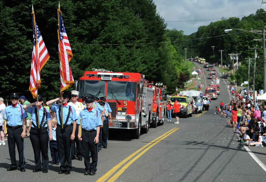Hundreds of people line the streets of downtown New Fairfield to watch the Annual Independence Day Parade, sponsored by the New Fairfield Lions Club, on Thursday, July 4, 2013. Photo: Tyler Sizemore / The News-Times