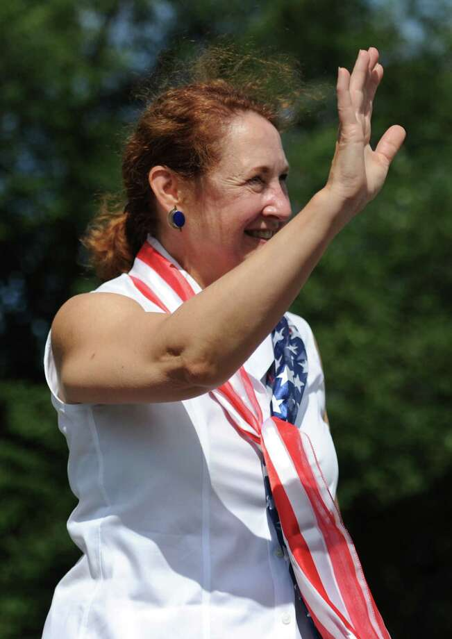 Congresswoman Elizabeth Esty, of Connecticut's Fifth District, waves to the crowd while walking in the Annual Independence Day Parade in New Fairfield, Conn. on Thursday, July 4, 2013.  Hundreds of people lined the streets of downtown New Fairfield to watch the festivities, sponsored by the New Fairfield Lions Club. Photo: Tyler Sizemore / The News-Times