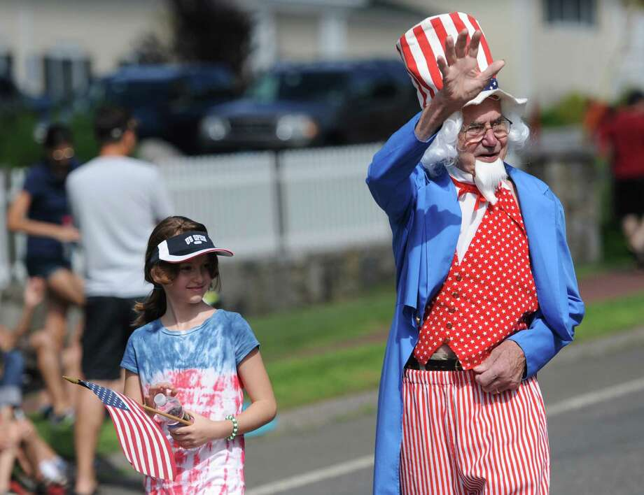 Uncle Sam waves to the crowd at the Annual Independence Day Parade in New Fairfield, Conn. on Thursday, July 4, 2013.  Hundreds of people lined the streets of downtown New Fairfield to watch the festivities, sponsored by the New Fairfield Lions Club. Photo: Tyler Sizemore / The News-Times