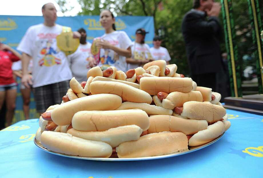 NEW YORK, NY - JULY 03:  Hot dogs sit on a plate during the Nathan's Famous Fourth of July International Hot Dog Eating Contest weigh-in ceremony on July 3, 2013 in the Brooklyn borough of New York City. The annual hot dog eating event is expected to draw up to 40,000 fans on July 4, in the Coney Island section of Brooklyn. Photo: Mario Tama, Getty Images / 2013 Getty Images