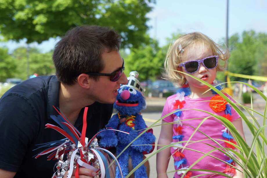 Chris Chattaway with his daughter Juliet acompanied Elmo at the Push or Pull Parade in Darien. 7/4/2013 Photo: Todd Tracy/ Hearst Connecticut Media Group