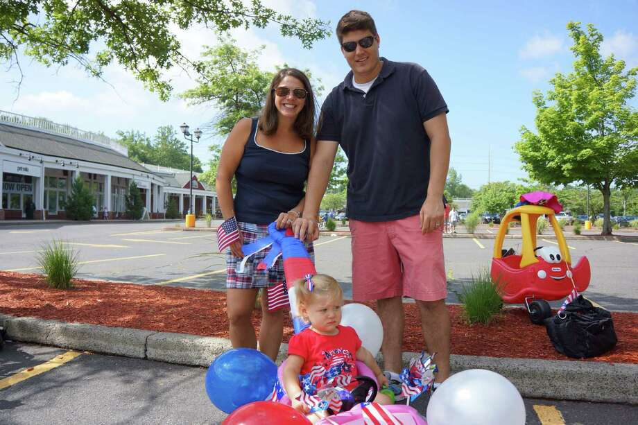 Nick and Eva Rongo with their child Tony Ann in anticipation of joining the Push or Pull Parade in Darien. 7/4/2013 Photo: Todd Tracy/ Hearst Connecticut Media Group