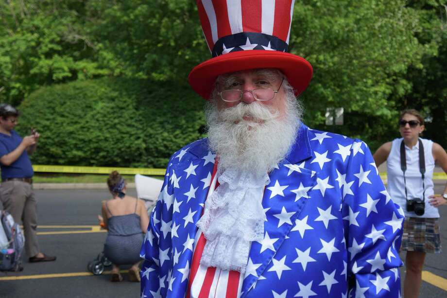 Uncle Sam was the master of ceremonies at the Push or Pull Parade in Darien, as he has been for the last 8 years. 7/4/2013 Photo: Todd Tracy/ Hearst Connecticut Media Group