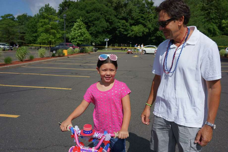 Audrey Sears with her dad at the Push or Pull Parade in Darien. 7/4/2013 Photo: Todd Tracy/ Hearst Connecticut Media Group