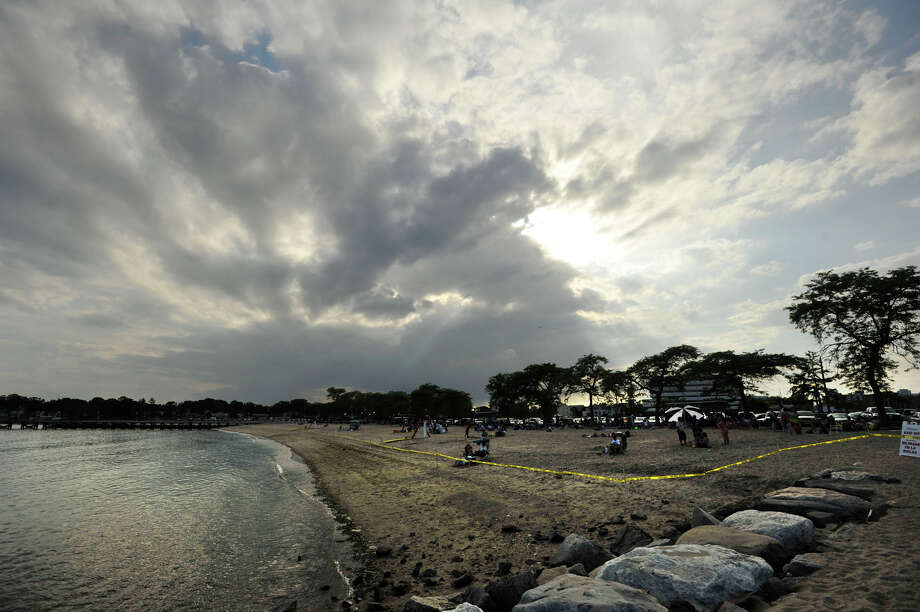 Clouds gather in the evening over Cummings Park beach prior to the fireworks show there on Wednesday, July 3, 2013. Photo: Jason Rearick / Stamford Advocate