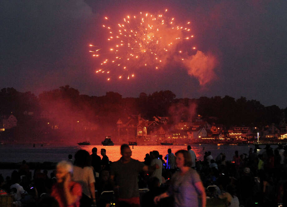 A private residence fires off their own fireworks prior to the main fireworks show during the fireworks celebration at Cummings Park beach on Wednesday, July 3, 2013. Photo: Jason Rearick / Stamford Advocate