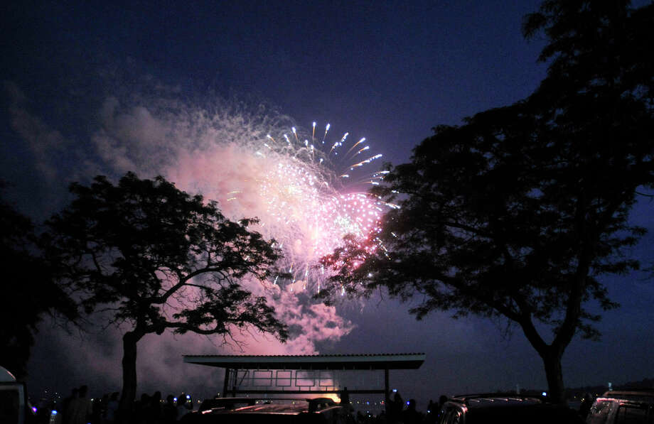 Spectators watch the fireworks at Cummings Park beach on Wednesday, July 3, 2013. Photo: Jason Rearick / Stamford Advocate