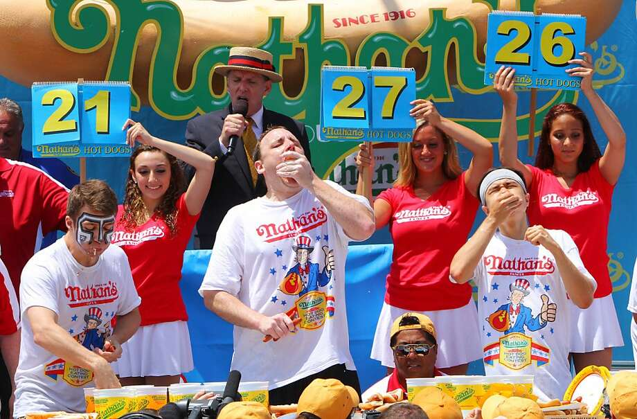 NEW YORK, NY- JULY 04:  (L to R) Tim Janus, Joey Chestnut, and Matt Stonie compete in the Nathan's Famous Fourth of July Hot Dog Eating Contest at Nathan's Famous in Coney Island on July 4, 2013 in the Brooklyn borough of New York City. Chestnut, of San Jose, California, ate 69 hotdogs in ten minutes to win his seventh straight title. (Photo by Monika Graff/Getty Images) Photo: Monika Graff, Getty Images