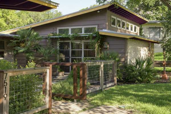 Cathy Eignus painted the eaves purple and yellow to give her 1963 Oak Park house an element of surprise.