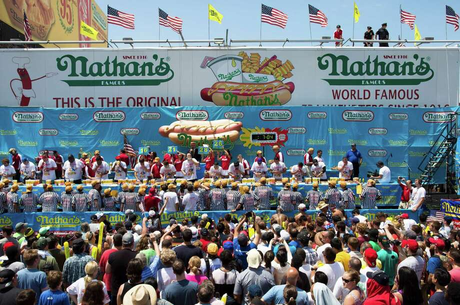 The Nathan's Famous Fourth of July International Hot Dog Eating contest men's competition kicks off in front of crowds of fans at Coney Island, Thursday, July 4, 2013 at Coney Island, in the Brooklyn borough of New York. Photo: John Minchillo