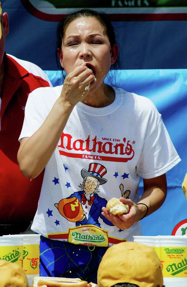 NEW YORK, NY- JULY 04:  Sonya Thomas competes in the women's division of the Nathan's Famous Fourth of July Hot Dog Eating Contest at Nathan's Famous in Coney Island on July 4, 2013 in the borough of Brooklyn in New York City. Thomas of Alexandria, Virginia, held onto her title after downing 37 hot dogs in ten minutes. Photo: Monika Graff, Getty Images / 2013 Getty Images