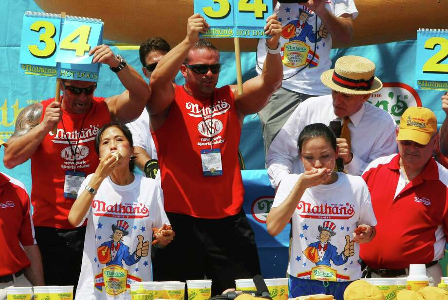 NEW YORK, NY- JULY 04:  Juliet Lee (L) and Sonya Thomas compete in the women's division of the Nathan's Famous Fourth of July Hot Dog Eating Contest at Nathan's Famous in Coney Island on July 4, 2013 in the borough of Brooklyn in New York City. Thomas of Alexandria, Virginia, held onto her title after downing 37 hot dogs in ten minutes. Photo: Monika Graff, Getty Images / 2013 Getty Images