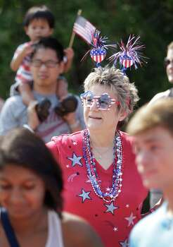 Georgia Anderson, center, watches the Kingwood Civic Club 4th of July Parade Thursday, July 4, 2013, in Kingwood. Photo: Melissa Phillip, Houston Chronicle / © 2013  Houston Chronicle