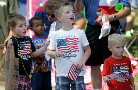John David Krebs, 5, left, and his brothers, Billy Krebs, 7, center, and Luke Krebs, 3, right, watch during the Kingwood Civic Club 4th of July Parade Thursday, July 4, 2013, in Kingwood. Photo: Melissa Phillip, Houston Chronicle / © 2013  Houston Chronicle