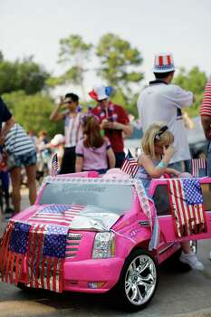 6-year-old Lila Humphrey waits in her toy Cadillac Escalade adorned with patriotic flags prior to an Independence Day parade, Thursday, July 4, 2013 in Bellaire, Texas. (PHOTO BY TODD SPOTH) Photo: © TODD SPOTH PHOTOGRAPHY, LLC / © TODD SPOTH PHOTOGRAPHY, LLC