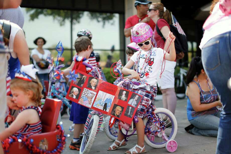 Bike parade participants prepare for the Independence Day parade, Thursday, July 4, 2013 in Bellaire, Texas. (PHOTO BY TODD SPOTH) Photo: © TODD SPOTH PHOTOGRAPHY, LLC / © TODD SPOTH PHOTOGRAPHY, LLC