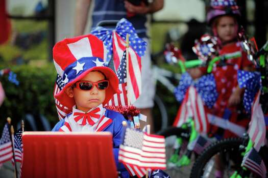 3-year-old Gabriel Cruz in full patriotic gear waits patiently for the Independence Day parade to begin, Thursday, July 4, 2013 in Bellaire, Texas. (PHOTO BY TODD SPOTH) Photo: © TODD SPOTH PHOTOGRAPHY,  LLC / © TODD SPOTH PHOTOGRAPHY, LLC