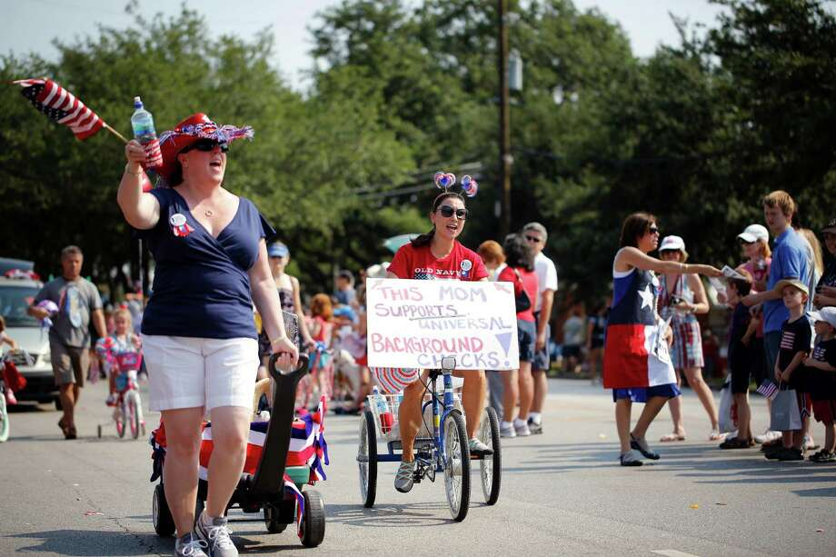 Members of Moms Demand Action make their way down the parade route, during an Independence Day parade, Thursday, July 4, 2013 in Bellaire, Texas. (PHOTO BY TODD SPOTH) Photo: © TODD SPOTH PHOTOGRAPHY, LLC / © TODD SPOTH PHOTOGRAPHY, LLC