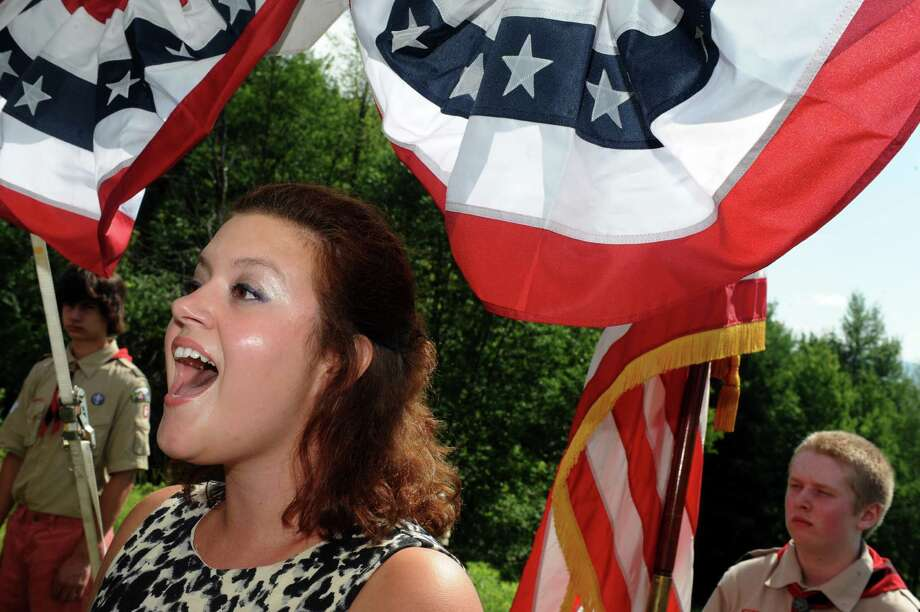 Danielle McMullen sings the National Anthem during a citizenship ceremony  at the Saratoga National Historic Park on Thursday July 4, 2013 in Stillwater, N.Y. (Michael P. Farrell/Times Union) Photo: Michael P. Farrell / 00023028A