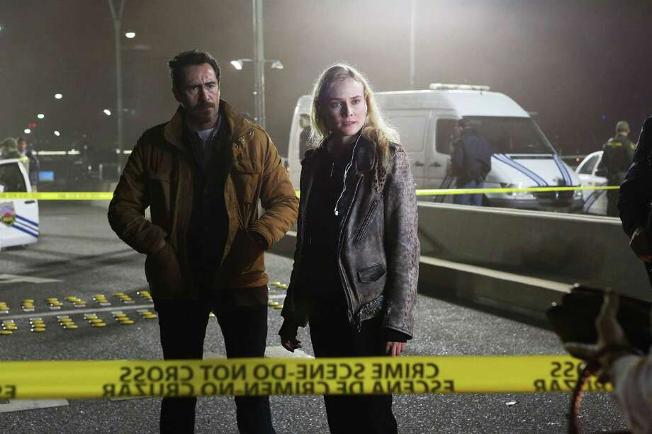 "Mexican detective Marco (Demián Bichir) teams up with Sonya (Diane Kruger), a by-the-book officer from El Paso, to investigate a judge's murder in ""The Bridge."" Photo: FX"
