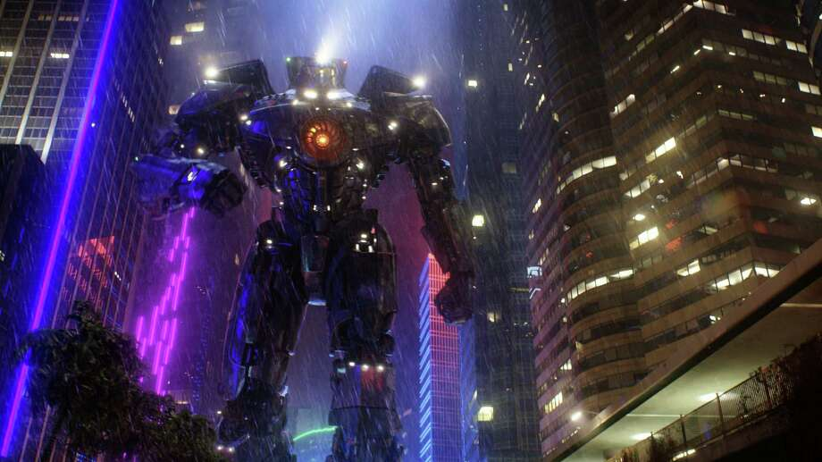 """Pacific Rim""  fulfills a very basic boyhood fantasy: big ol' robots and giant monsters slugging it out. Photo: Warner Bros."