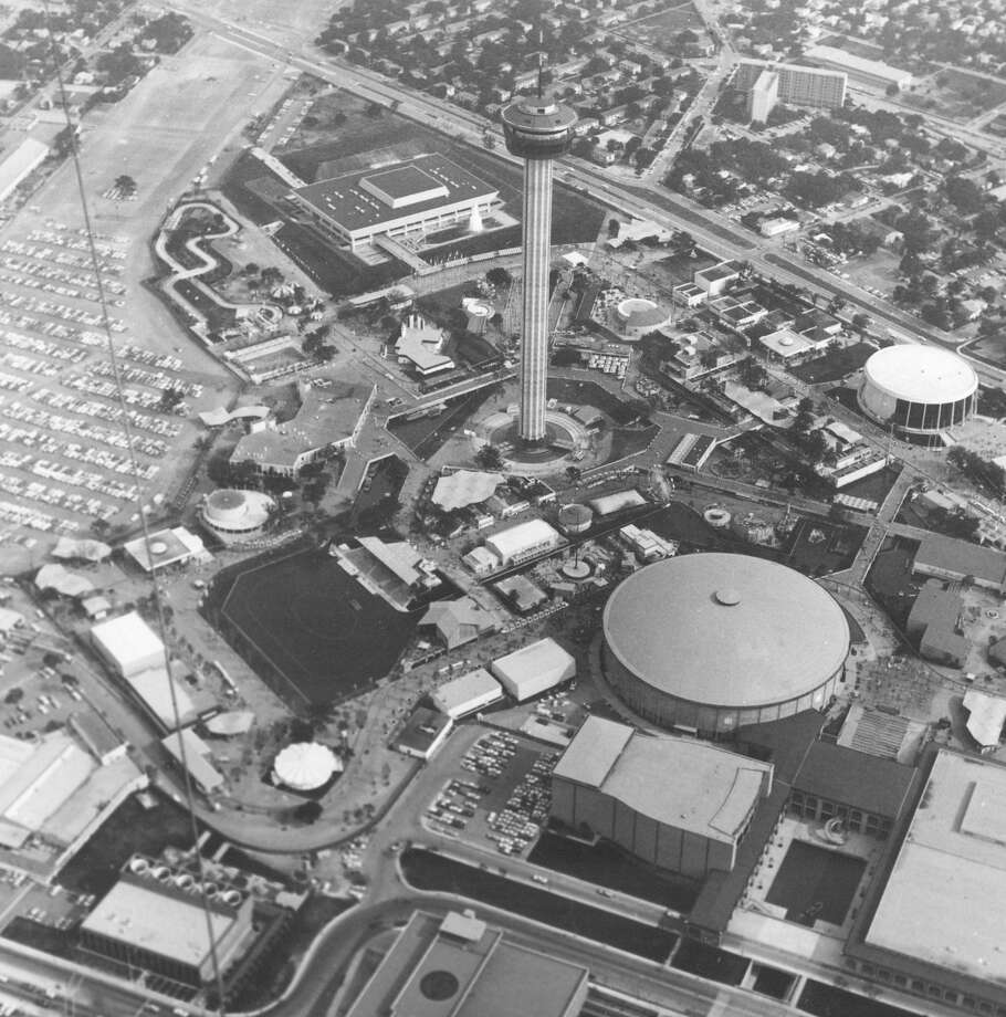 An undated aerial shot of the HemisFair grounds shows the Tower of the Americas in the center. The Lake Pavilion, where Club Abrazo was located, is north of the lake (dark area southwest of the tower). The club was used to entertain prominent visitors to HemisFair '68. Photo: UTSA Libraries Special Collections