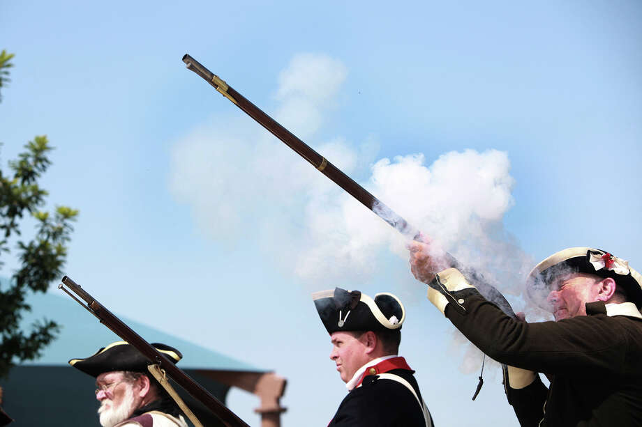 Men dressed as American soldiers fire muskets at the 29th annual Independence Day ceremony to remember veterans on Thursday, July 4, 2013 at Fort Sam Houston National Cemetery. Photo: Abbey Oldham, San Antonio Express-News / © San Antonio Express-News