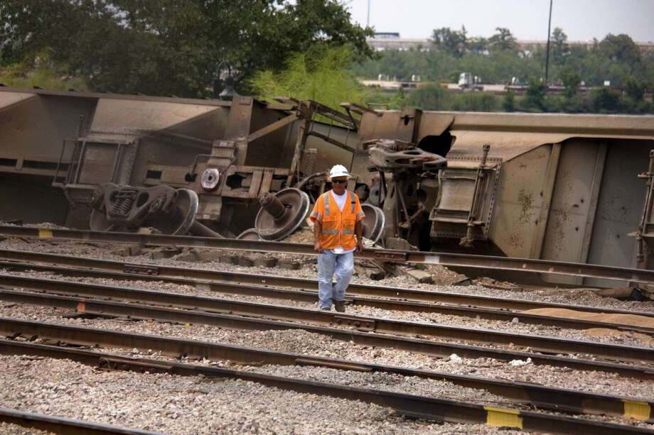 Emergency crews were called to the train tracks behind the Beaumont Civic Center Thursday afternoon when a train derailed. No injuries were reported. Photo: Tim Monzingo