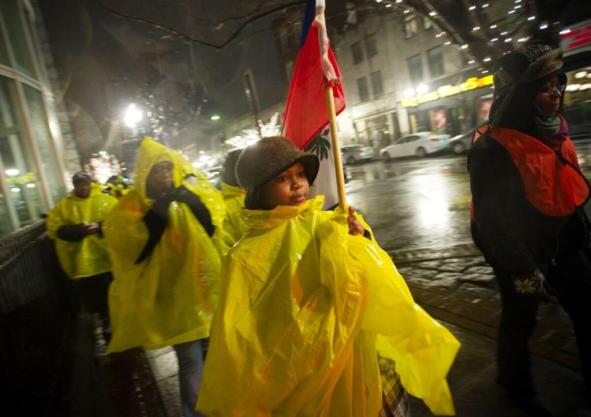 Thacheka Lauture, 12, leads candlelight march for the victims of the earthquake in Haiti from downtown Stamford to the Haitian American Catholic Center on Hope St. in Stamford, Conn. on Sunday, Jan. 17 2009.
