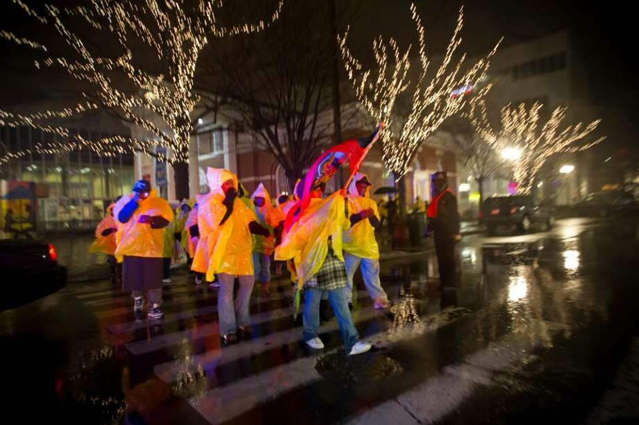 A candlelight march for the victims of the earthquake in Haiti from downtown Stamford to the Haitian American Catholic Center on Hope St. in Stamford, Conn. on Sunday, Jan. 17 2009. Photo: Chris Preovolos / Stamford Advocate