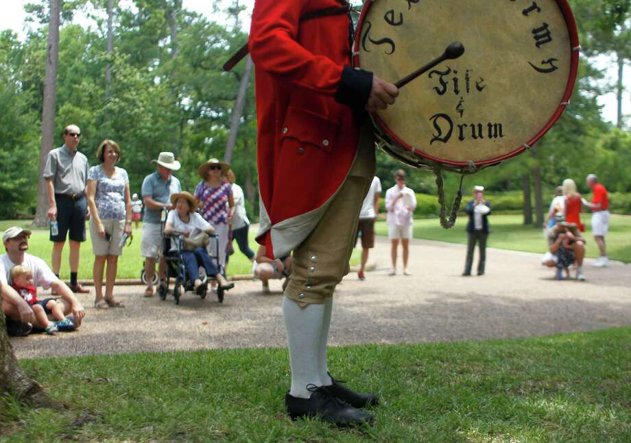 Cameron Lyman, with the reenactment band named the Texas Army Fife & Drum, performs as Bayou Bend celebrated Independence Day Thursday, July 4, 2013, in Houston. 