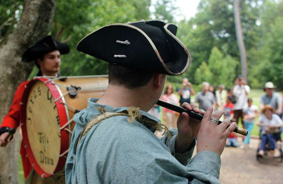 Noah Heckathorne, right, and Cameron Lyman, with the reenactment band named the Texas Army Fife & Drum, perform as Bayou Bend celebrated Independence Day Thursday, July 4, 2013, in Houston. 