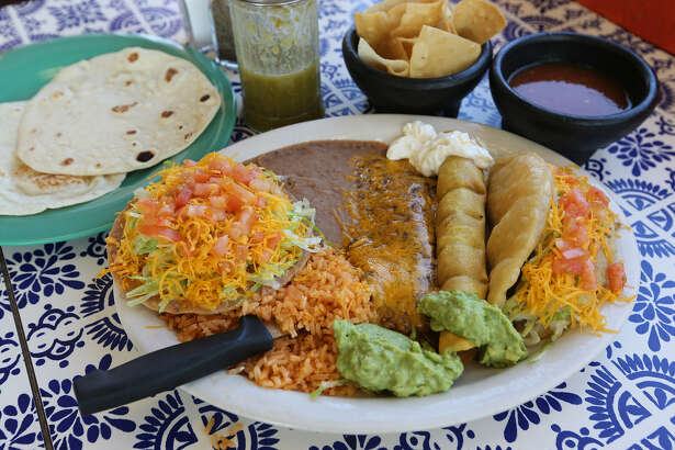 The Carmelita's platter includes a little of everything: flauta, puffy taco, enchilada, tostada and sides.